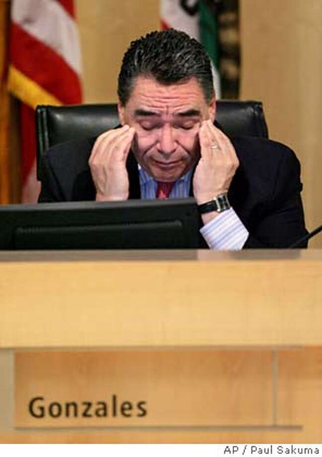 San Jose Mayor Ron Gonzales wipes his eyes just before the San Jose City Council voted to censure him during a city council meeting in San Jose, Calif., Tuesday, Dec. 13, 2005. The San Jose City Council voted to censure Gonzales for his handling of a controversial trash hauling deal. (AP Photo/Paul Sakuma) Photo: PAUL SAKUMA