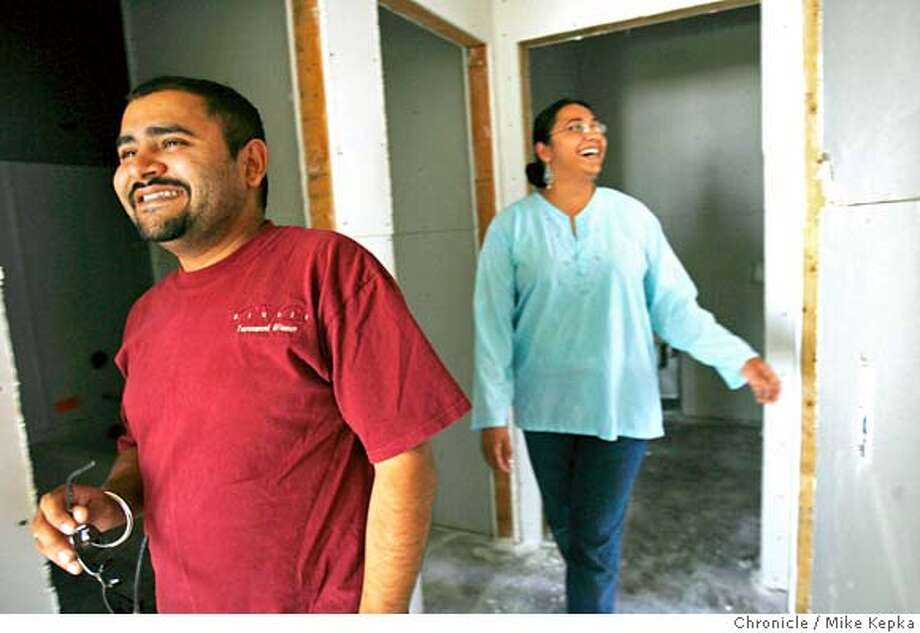 elkgrove200_mk.JPG Satjit Thind, 30, and his wife Sandeep Toor, 27, excitedly check on the construction progress of their new home in one of Elk Grove's newest developments called Sheldon Place. They said they are moving here from Galt, CA because all their friends and family have recently move to the city. They also feel like this town offers conveniently location restaurant and stores to use. In Elk Grove Tuesday June 20, 2006.  Mike Kepka / THe Chronicle Satjit Thind, Sandeep Toor (cq) MANDATORY CREDIT FOR PHOTOG AND SF CHRONICLE/ -MAGS OUT Photo: Mike Kepka