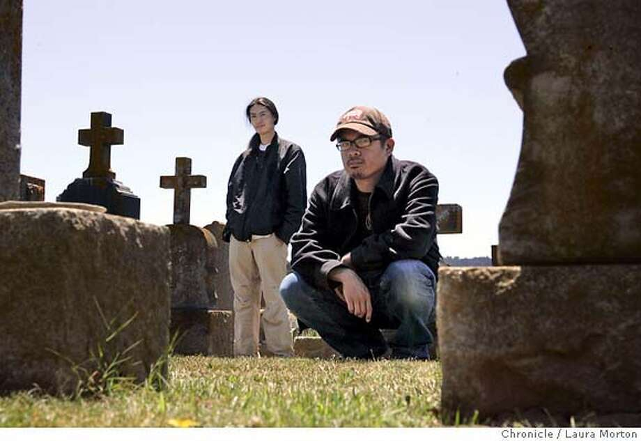 "colma19629_lm.JPG Richard Wong (left) and H.P. Mendoza (right) of the film ""Colma: The Musical"" pose in a cemetery in Colma, CA on June,15, 2006. Wong directed ""Colma: The Musical"" and Mendoza wrote as well as acted in the film. Laura Morton/The Chronicle *** Richard Wong (cq)  *** H.P. Mendoza (cq) MANDATORY CREDIT FOR PHOTOGRAPHER AND SAN FRANCISCO CHRONICLE/ -MAGS OUT Photo: Laura Morton"