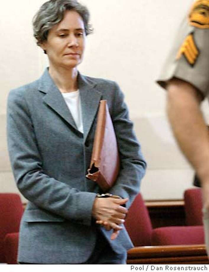 Susan Polk walks into court on the first day of her murder trial Tuesday morning, Oct. 11, 2005, in Martinez, Calif. Polk is accused of murder in the death of her 70-year-old husband. (AP Photo/Dan Rosenstrauch, Pool) Photo: DAN ROSENSTRAUCH