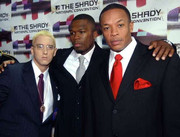 "Rappers Eminem, left, 50 Cent, center, and Dr. Dre pose for photographers after arriving at the Roseland Ballroom for a concert ""The Shady National Convention,"" in this Oct. 28, 2004 file photo taken in New York. Photo: RAMIN TALAIE, Associated Press / AP2004"