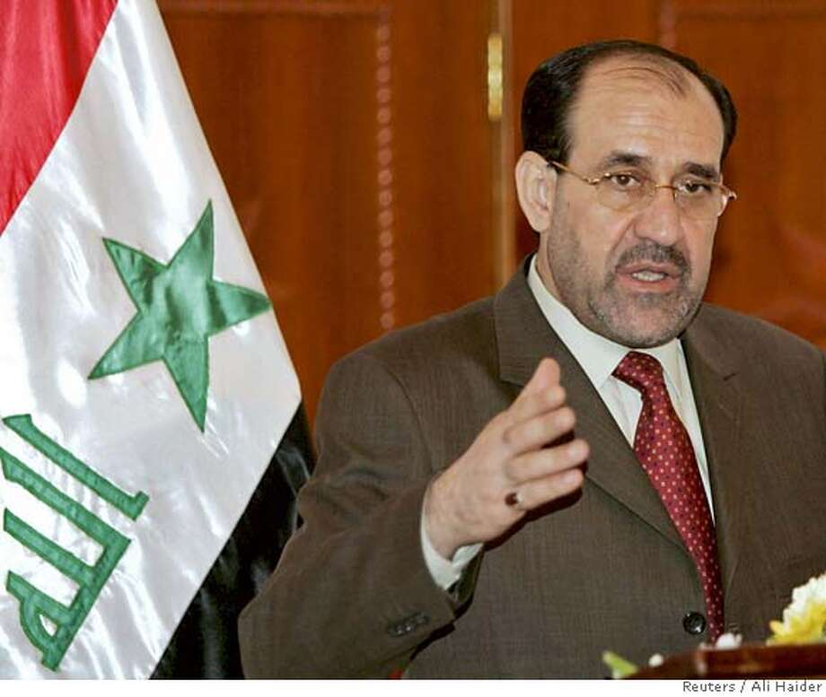 Iraqi PM Maliki gestures during news conference in Baghdad Photo: POOL