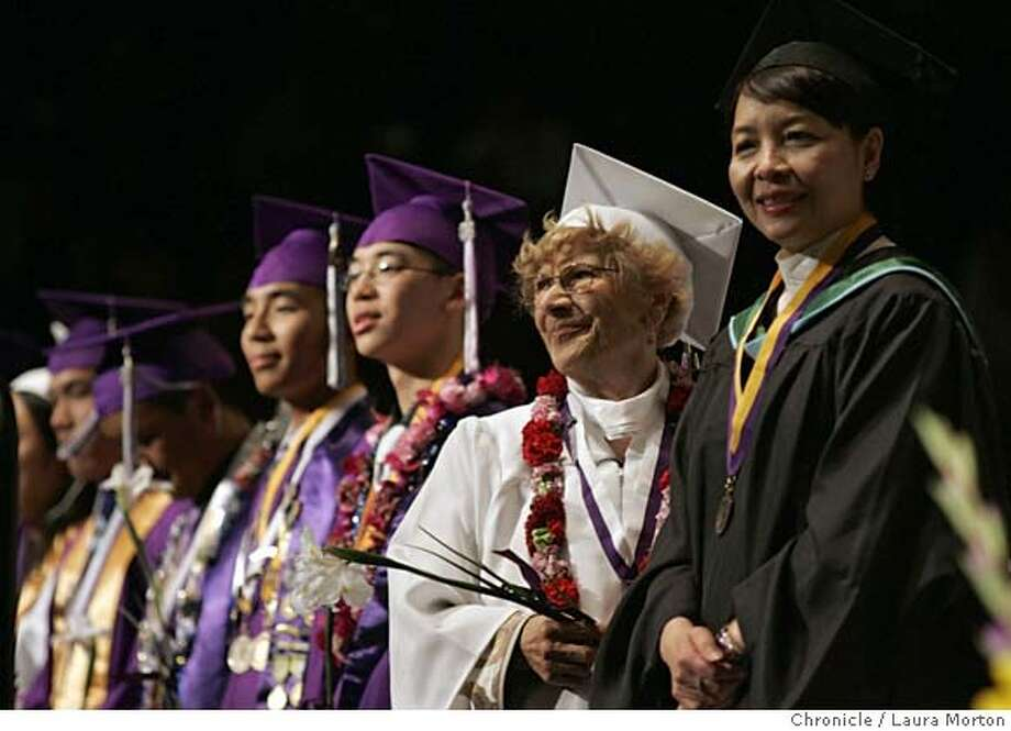 Oldgrad15566_lm.jpg 98-year-old Josephine Belasco (second from right) stands on stage during the Galileo Academy of Science and Technology graduation. Belasco received her diploma 80 years after dropping out of the school during her senior year. Laura Morton/The Chronicle MANDATORY CREDIT FOR PHOTOGRAPHER AND SAN FRANCISCO CHRONICLE/ -MAGS OUT Photo: Laura Morton