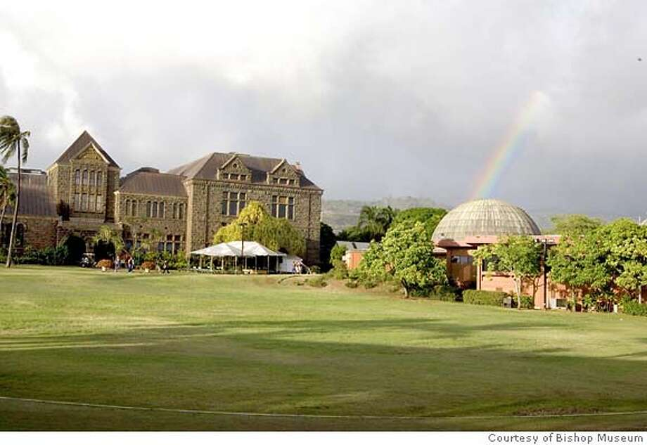 TRAVEL HAWAII -- A rainbow appears over the Bishop Museum, which includes a planetarium, right. Polynesians used the stars to navigate the Pacific Ocean, which led to Hawaii's discovery. Photo courtesy Bishop Museum Photo: HO