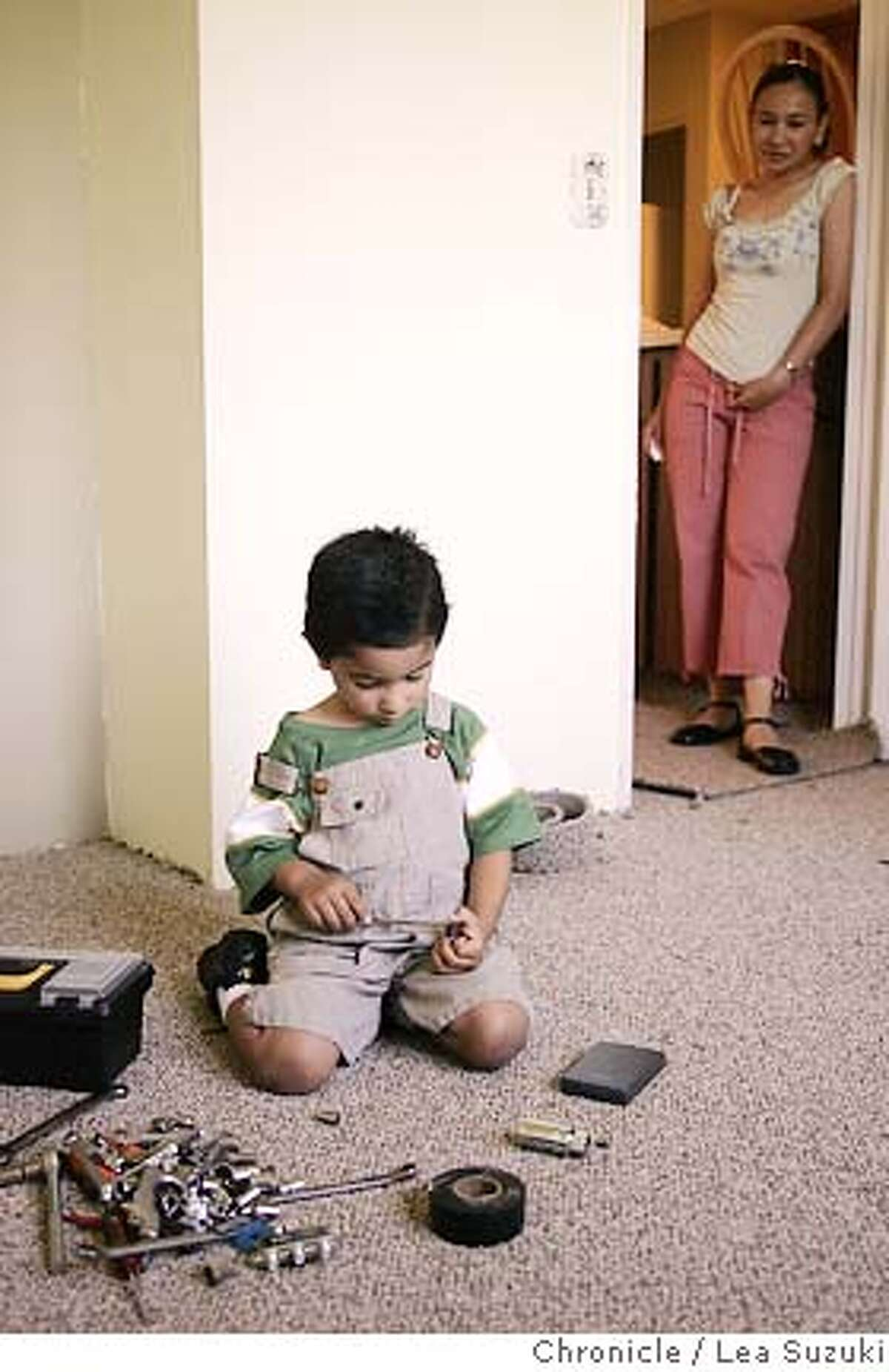 immigrant_mortgage_007_ls.JPG Alexis, 3, plays with tools from his father's toolbox as his mother, Marisol, looks upon him at 312 Stonegate Circle in San Jose on Sunday June 4, 2006. Photo by LEA SUZUKI/The San Francisco Chronicle Photo taken on 6/4/06, in San Jose, CA, USA *cq