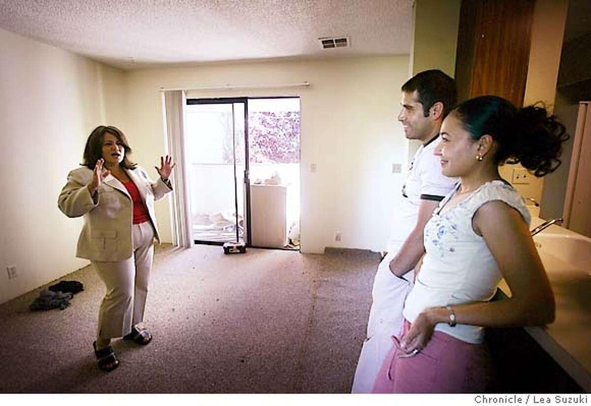 immigrant_mortgage_079_ls.JPG From left: Rebecca Gallardo-Serrano(realtor) , Ramiro and Marisol talk with each other at 312 Stonegate Circle in San Jose on Sunday June 4, 2006. Photo by LEA SUZUKI/The San Francisco Chronicle Photo taken on 6/4/06, in San Jose, CA, USA **cq