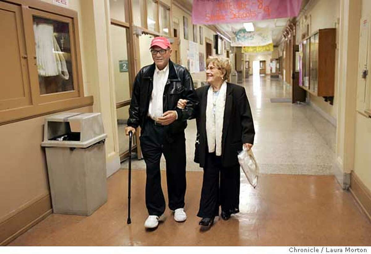 Oldgrad14135_lm.jpg Ninety-eight-year-old Josephine Belasco (right) walks through the halls of Galileo High School with her son Eddie Belasco after picking up her graduation cap and gown on Tuesday, June 13, 2006. Belasco is finally getting her diploma after dropping out during her senior year in the 1920s. Laura Morton/The Chronicle *** Josephine Belasco *** Eddie Belasco Ran on: 06-14-2006 Josephine Belasco is congratulated by Bettie Grinnell while trying on her cap and gown.
