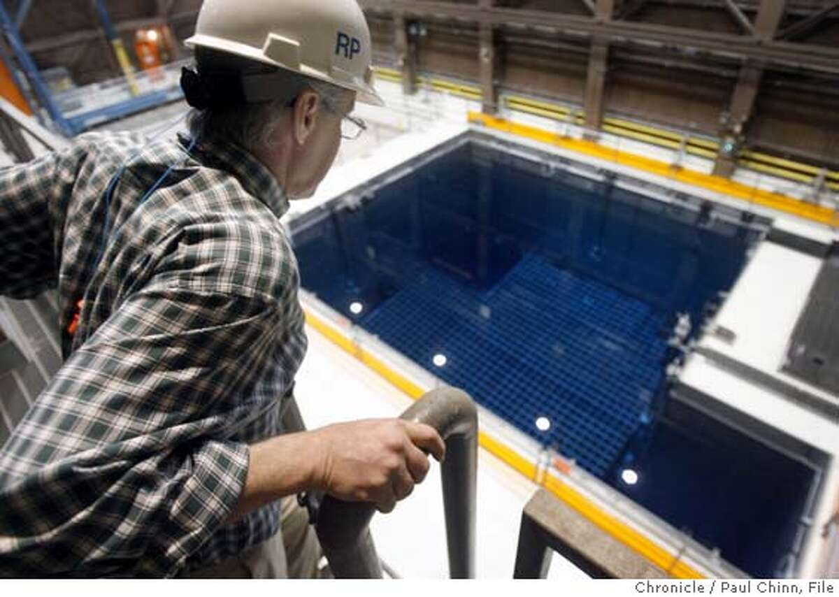 Radiation protection physicist Mark Somerville gets an overhead look at one of the spent fuel storage pool inside PG&E's Diablo Canyon nuclear power plant in Avila Beach, Calif. on Friday, May 26, 2006. The two spent fuel storage pools are nearing its capacity of 2,648 cells so plant officials are constructing a dry cask storage area to hold future radioactive fuel cell waste. PAUL CHINN/The Chronicle **Mark Somerville MANDATORY CREDIT FOR PHOTOGRAPHER AND S.F. CHRONICLE/ - MAGS OUT