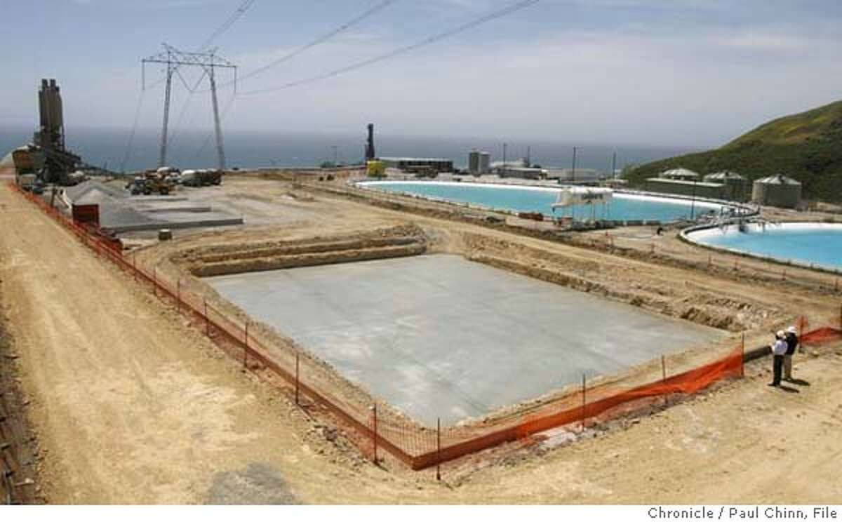 The concrete foundation for the new dry cask storage lot has already been poured at PG&E's Diablo Canyon nuclear power plant in Avila Beach, Calif. on Friday, May 26, 2006. The two spent fuel storage pools are nearing its capacity of 2,648 cells so plant officials are constructing the new storage area to hold future radioactive fuel cell waste. PAUL CHINN/The Chronicle MANDATORY CREDIT FOR PHOTOGRAPHER AND S.F. CHRONICLE/ - MAGS OUT