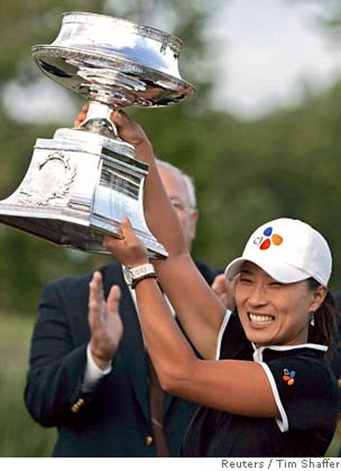 Pak holds the trophy after winning the LPGA Championship golf tournament in Maryland Photo: TIM SHAFFER