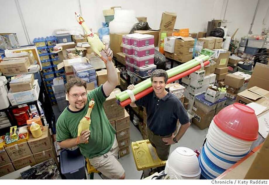 .JPG  SHOWN: L: Tim Horvat, a warehouse assistant; R: Glen Tripp, CEO of Camp Galileo. They are posing with rubber chickens (their company mascot) and pool noodles, surrounded by just SOME of the vast quantity of stuff they deal with. Story is about the huge quantity and variety of STUFF it takes to run a camp. Camp Galileo is the name of the company that is in the business of running a summer camp. Photo shot in Berkeley, CA. on Monday, June 5, 2006. (Katy Raddatz/The Chronicle)  Photo taken on 6/5/06, in San Francisco, CA.  **Tim Horvat, Glen Tripp Photo: Katy Raddatz