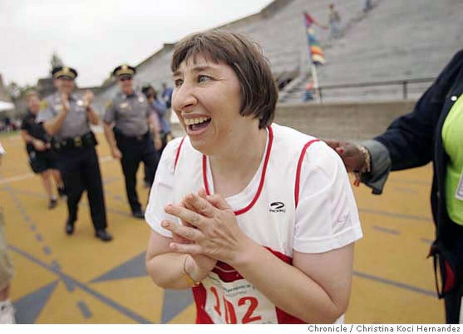 Lisa Palmer (cq), 41, of Fresno, CA, celebrates after she wins a 400 meter race. She has competed in the games since she was 8 years-old. Over 1,000 athletes compete in various sports at the 2006 Special Olympics Northern California Summer Games, taking place in Berkeley, CA..Special Olympics Northern California provides year round sports training and competition opportunities for children and adults with developmental disabilities  (CHRISTINA KOCI HERNANDEZ/THE CHRONICLE)  . Lisa Palmer(cq) Mandatory Credit For Photographer and San Francisco Chronicle/No-Sales-Mags Out Photo: Christina Koci Hernandez