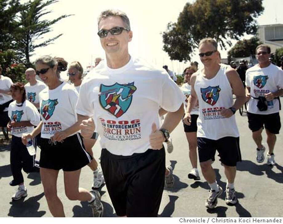(Foremost man with sunglasses) Newly elected sheriff for Alameda County, Greg Ahern, (cq)runs with other law enforcement personnel, from the Berkeley Marina to UC Berkeley to kick-off the start of the Special Olympics.(CHRISTINA KOCI HERNANDEZ/THE CHRONICLE)  *Greg Ahern (cq) Mandatory Credit For Photographer and San Francisco Chronicle/No-Sales-Mags Out Photo: Christina Koci Hernandez