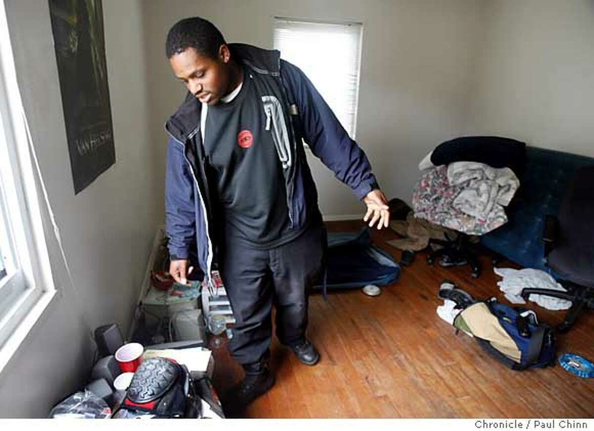Jason Martin retrieves his belongings in the Villa Parkmerced apartment where he's been living in San Francisco, Calif. on Friday, June 9, 2006. Martin was asleep in his bedroom on Tuesday evening when his friend Asa Sullivan, who was staying with Martin, knocked on his door to alert him the police had arrived. Police officers shot and killed Sullivan who they found hiding in the attic after believing he was armed but he was holding an eyeglasses case. PAUL CHINN/The Chronicle **Jason Martin, Asa Sullivan Ran on: 06-10-2006 Jason Martin, in the apartment where he lived with roommate Asa Sullivan, says he told officers Sullivan didnt have a gun.