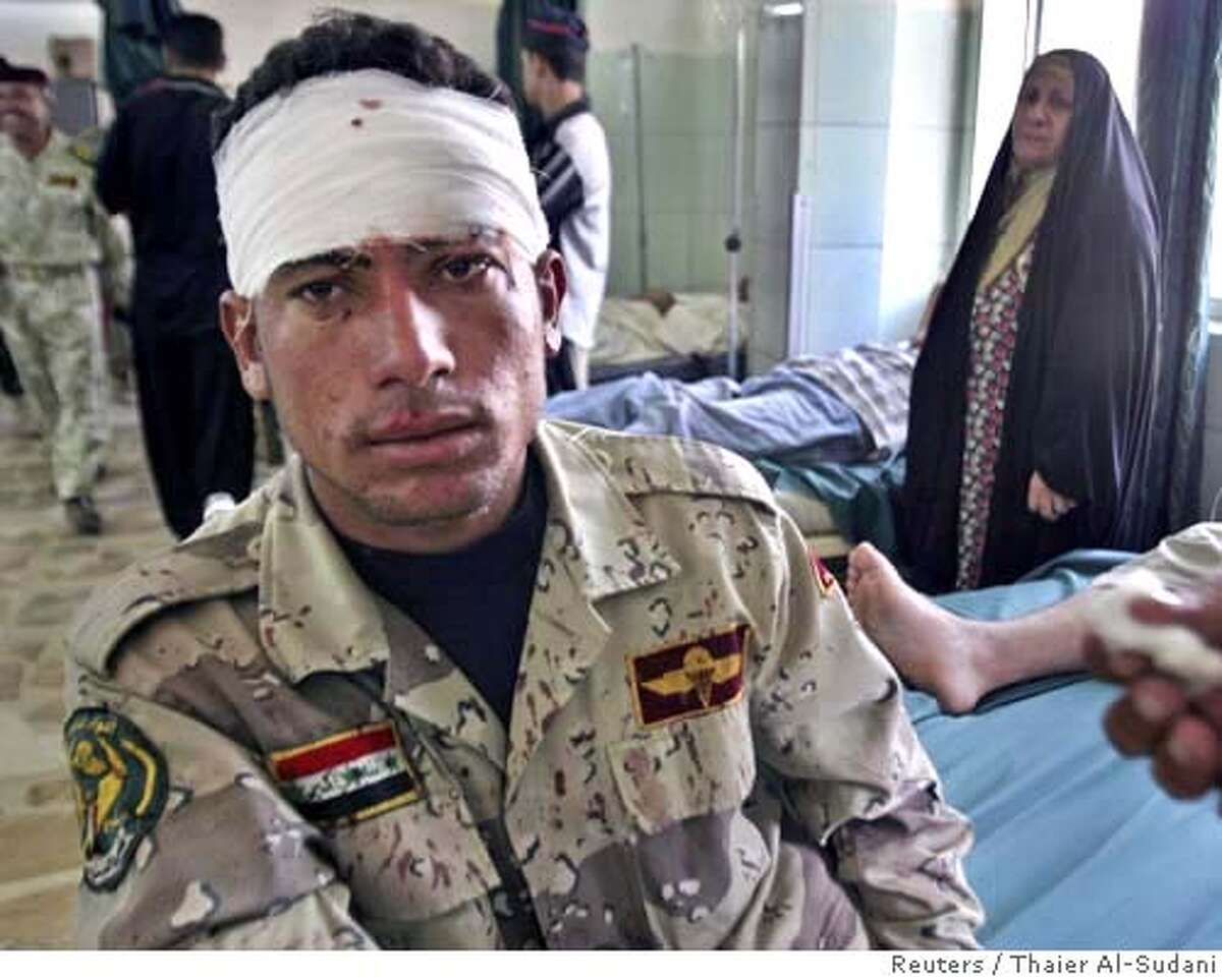 Iraqi soldier sits in hospital after being wounded by roadside bomb in southern Baghdad