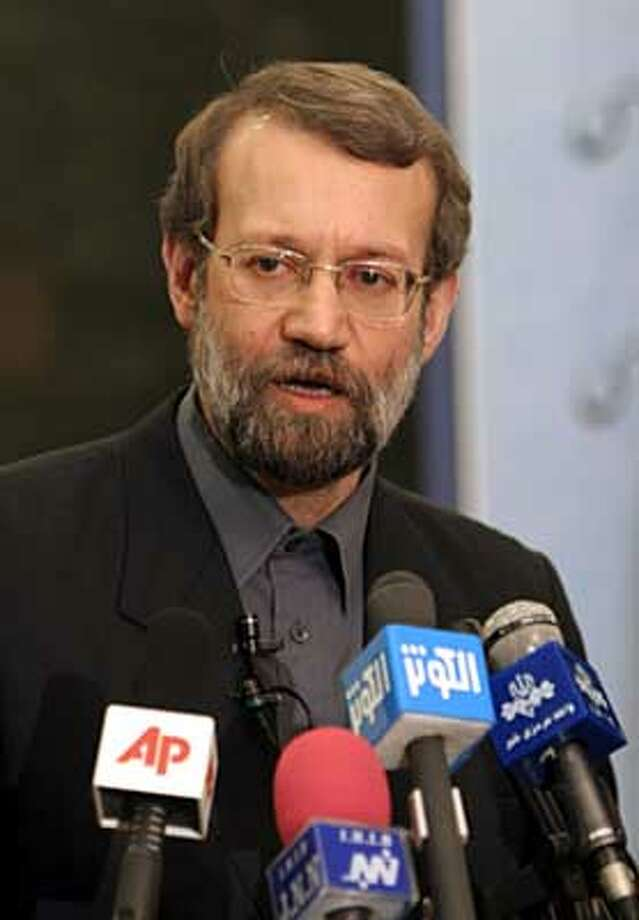Iran's top nuclear negotiator, Ali Larijani, who is also Iran's Secretary of Supreme National Security Council, speaks with the media, during a press conference after his meeting with lawmakers, at parliament in Tehran, Iran, Thursday, March 16, 2006. Iran's top nuclear negotiator said Thursday that Tehran was ready to open talks with the United States over the Iraqi issue, marking a major Iranian foreign policy shift. (AP Photo/Vahid Salemi) Photo: VAHID SALEMI