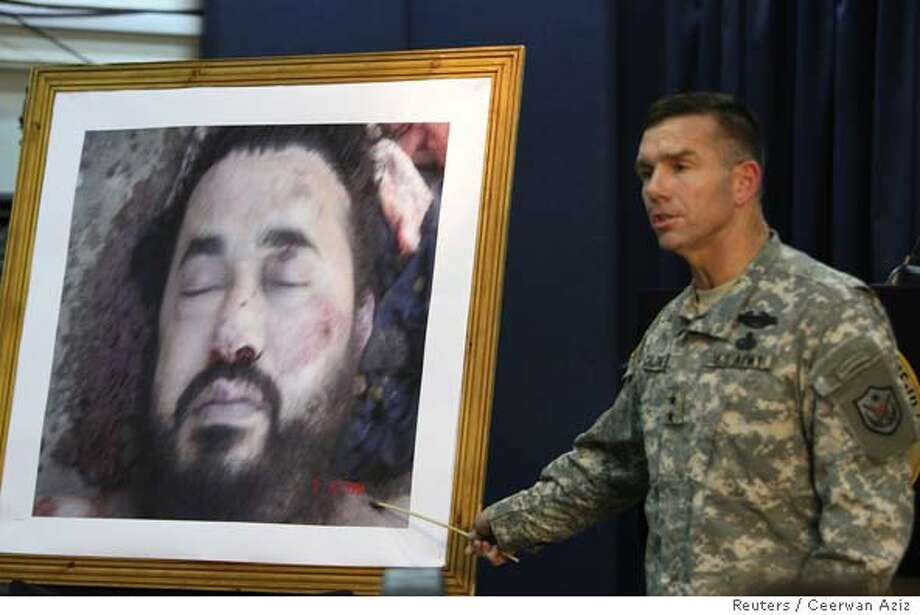 A picture of dead Al Qaeda leader in Iraq is displayed by the U.S. military in Baghdad Photo: CEERWAN AZIZ
