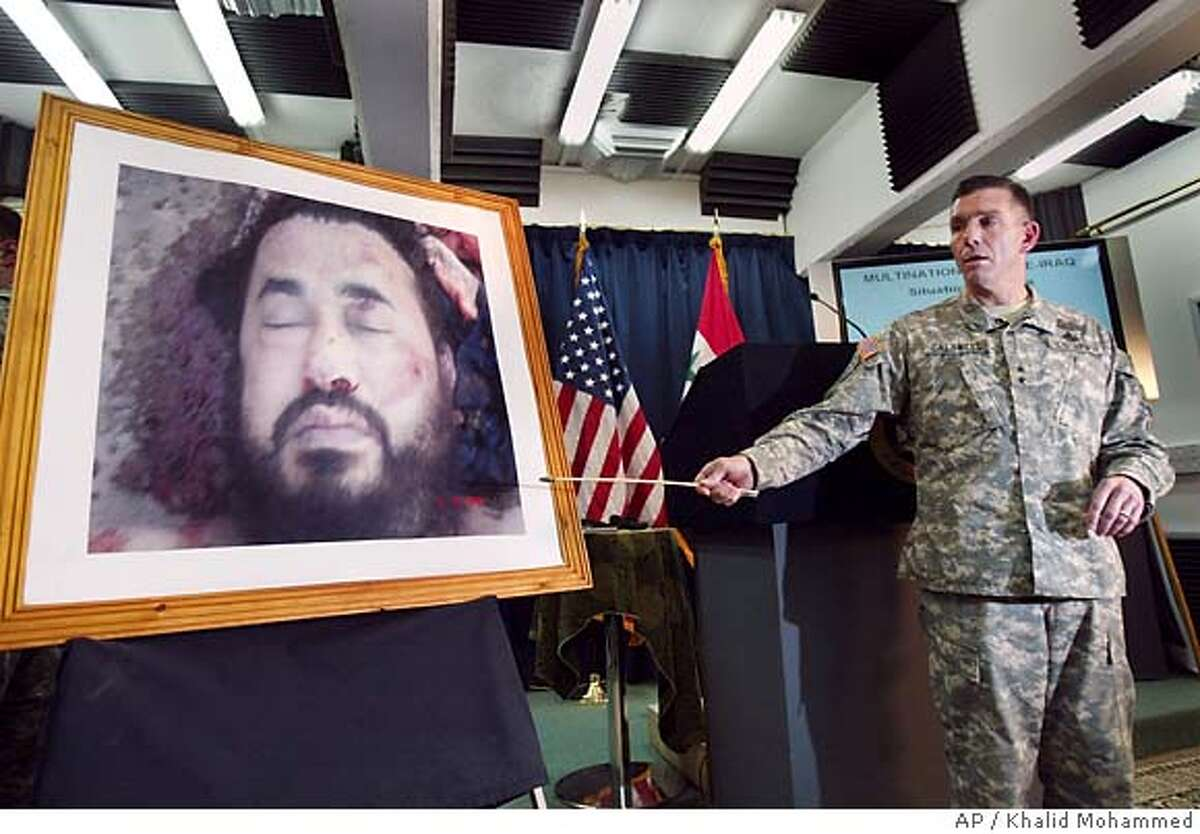 U.S. military spokesman Maj. Gen. William Caldwell at a press conference in Baghdad, Iraq pointing to a photo purporting to show the body of Abu Musab al-Zarqawi, the al-Qaida-linked militant who led a bloody campaign of suicide bombings, kidnappings and hostage beheadings in Iraq, who was killed Wednesday in a U.S. airstrike, Iraq's Prime Minister Nouri al-Maliki announced Thursday, June 8, 2006. (AP Photo/Khalid Mohammed)