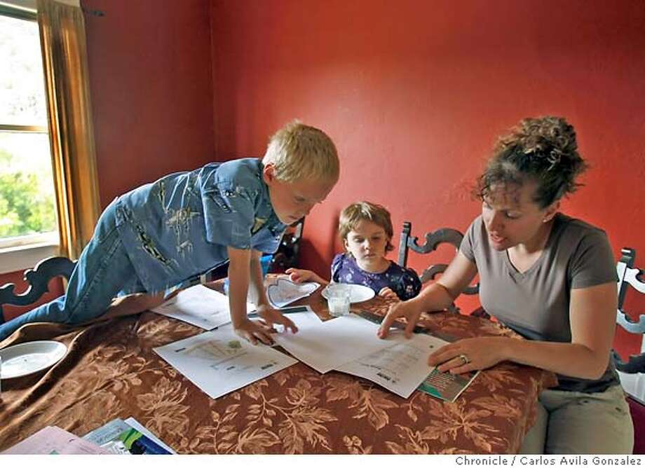 OUTPERFORM02_181_CAG.JPG  Laura Melendy and her two children, Nikos, 6, left, and Niobe, 5, center, in their Point Richmond home on Wednesday, May 31, 2006. Even as the overall Bay Area housing market has cooled, certain areas remain hot. Among them - Point Richmond. Laura and her husband bought a turn-of-the century house in Pt. Richmond last year for around $530,000. She said they bought there in part because they figured prices would appreciate at a healthy clip even if they went down in more expensive or far-flung areas.  Photo by Carlos Avila Gonzalez/The San Francisco Chronicle  Photo taken on 5/31/06, in San Francisco, CA, USA MANDATORY CREDIT FOR PHOTOG AND SAN FRANCISCO CHRONICLE/ -MAGS OUT Photo: Carlos Avila Gonzalez