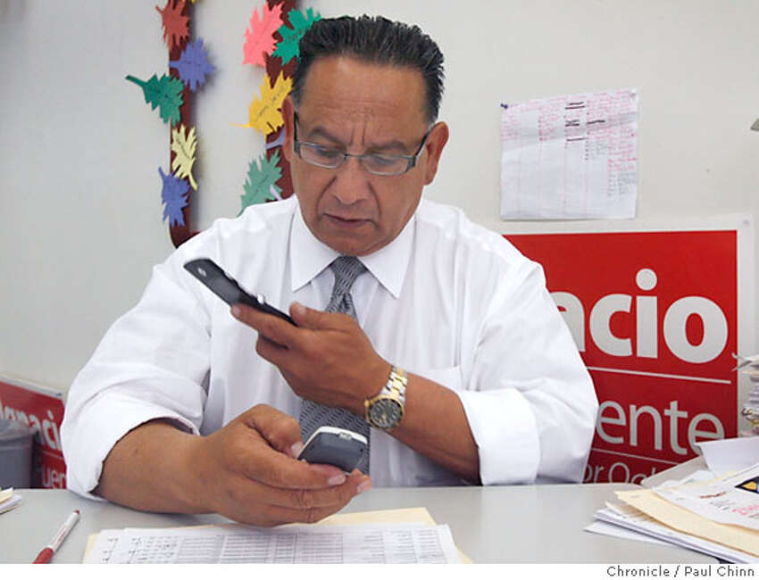 Mayoral candidate Ignacio De La Fuente had a phone in each hand as he made calls to voters from his campaign headquarters in Oakland, Calif. on Tuesday, June 6, 2006. PAUL CHINN/The Chronicle **Ignacio De La Fuente