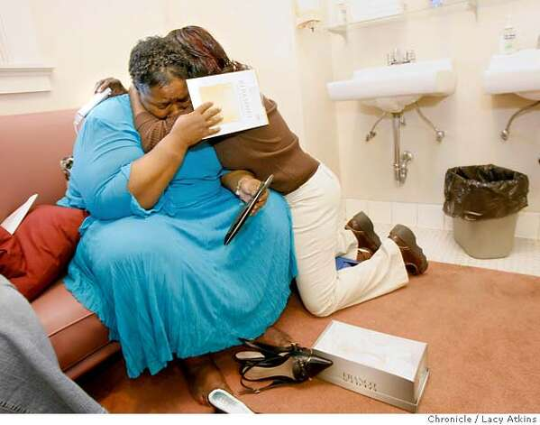 Paulette Hogan is comforted by her niece Alycia Williams in the ladies room at the First Presbyterian Church, before the Ambassadors of Change CD release program, Thursday June 1, 2006, in Oakland, Ca. Hogan was excited about teh performance but wished her mother, who passed away could have been there to witness it. More than 2 percent of all African Americans are HIV positive, a higher incidence than in any other group, according to a federal analysis of cases between 1999 and 2002. (Lacy Atkins/The Chronicle)  **Paulette Hogan**  *Alycia Williams(niece)** MANDATORY CREDITFOR PHOTGRAPHER AND SAN FRANCISCO CHRONICLE/ -MAGS OUT Photo: Lacy Atkins