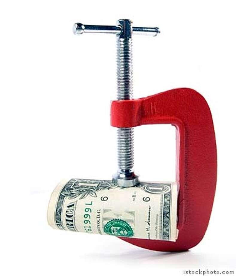 money vise squeeze Photo: Radiant Byte / IStockPhoto.com