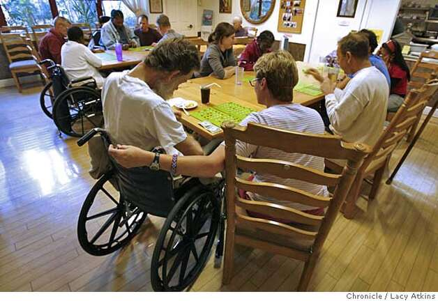 Residents gather to play Bingo in the dinning area on game night at the Maitri AIDS Hospice in San Francisco, May 1, 2006.  (Lacy Atkins/The Chronicle) Photo: Lacy Atkins