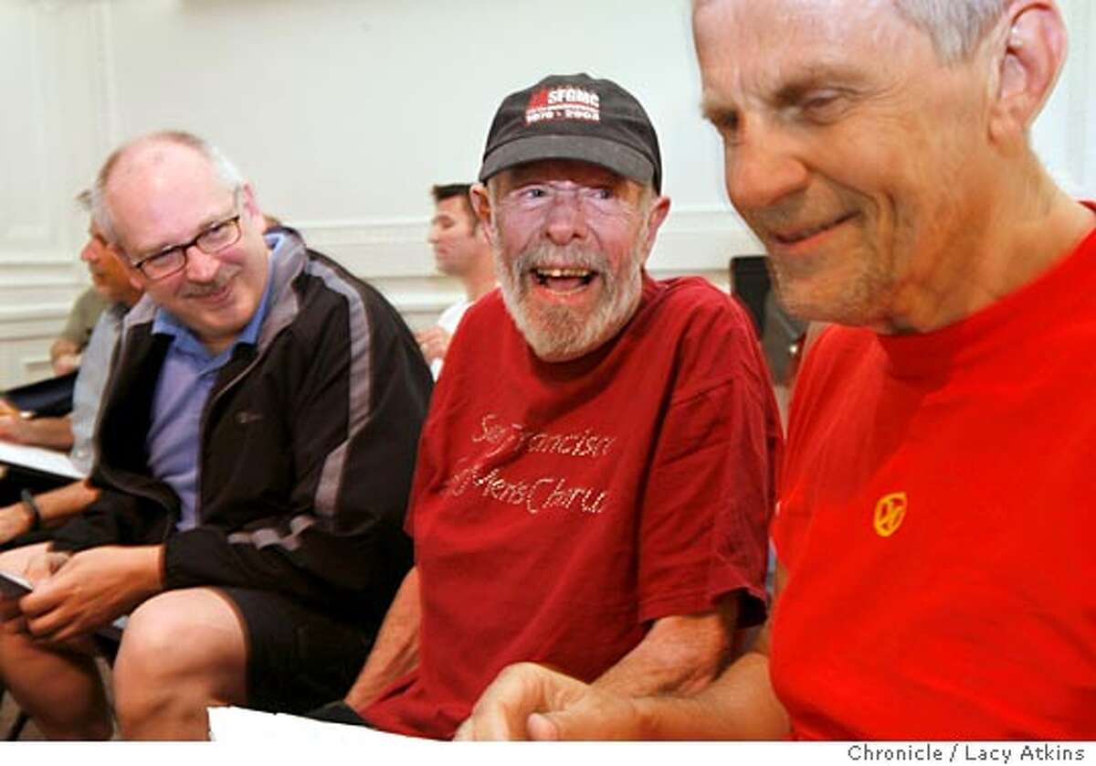 ( left to right) Jim Sweeney, Bob Emery and Bruce Friedrichsen enjoy a moment of laughter at the San Francisco Gay Mens Chorus rehearsal, May 15, 2006. This was Bobs first time back to rehearsal after a stay in the hospital. Photo By Lacy Atkins Ran on: 06-04-2006 The Gay Mens Chorus posed to illustrate the impact of AIDS. Those dressed in black, with their backs turned, represent those who had died. Today, all their backs would be turned because the obituary list is now 47 names longer than the chorus roster. For each man singing these days, more than one chorus member has died of AIDS.
