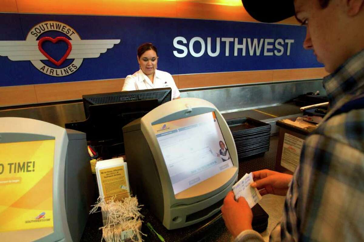 Southwest Airlines ticketing agent Amy Jackson, left, checks in customers last week at William P. Hobby Airport. Southwest is seeking the city's approval to build a new international terminal at the airport in south Houston.