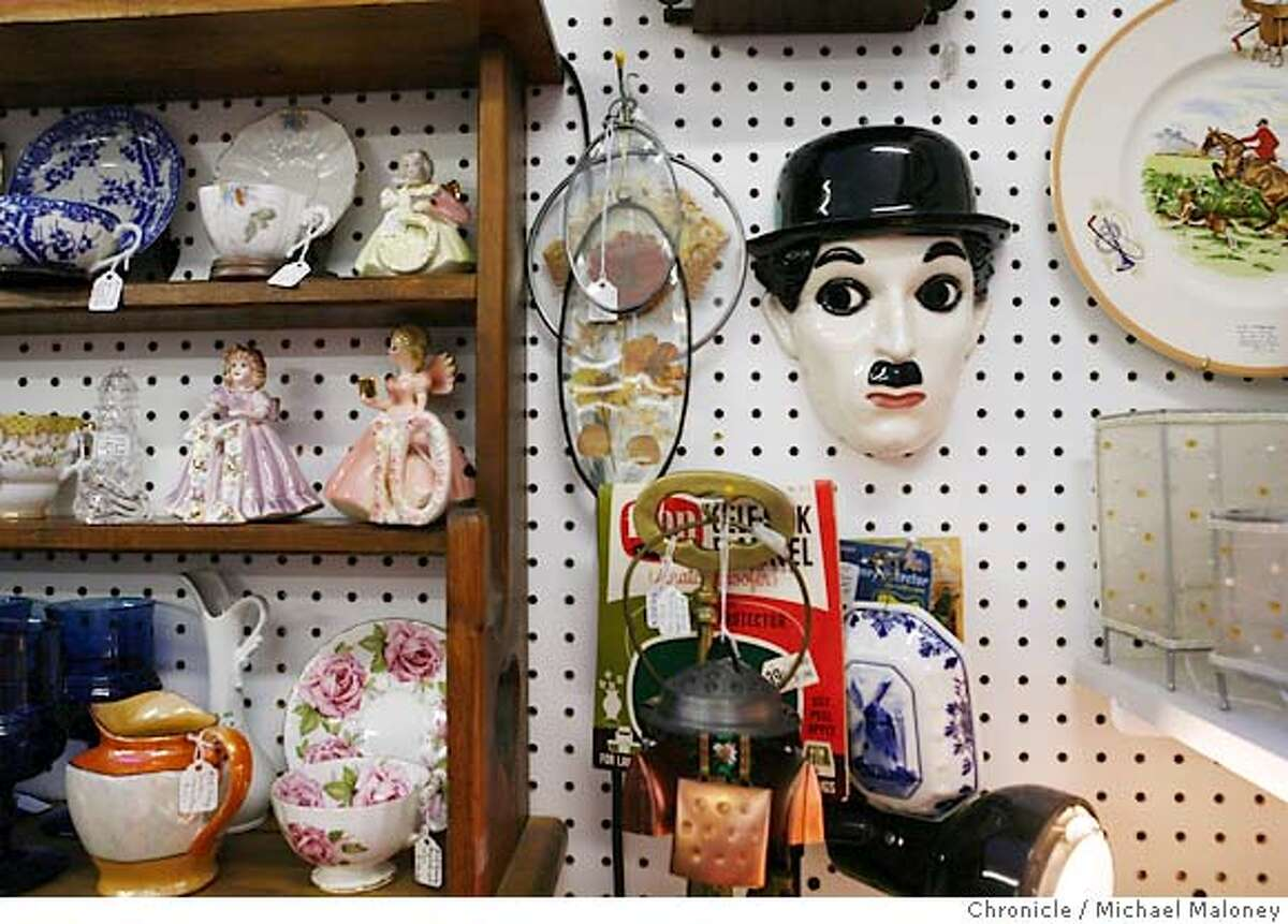Street Date - Niles Blvd., Fremont. A Charlie Chaplin wall hanging and other items for sale at Bite & Browse Antique Collective, one of many antique shops on Niles Blvd. Bite & Browse Antique Collective. 37565 Niles Blvd. (510) 796-4537 Photo by Michael Maloney / San Francisco Chronicle on 5/25/06 in Fremont,CA Ran on: 06-01-2006 Left, a Charlie Chaplin wall hanging at Bite & Browse Antique Collective; below far left, Wayne Corrie of Corrie Glass heats up a nugget of italian soft glass to shape it into jewelry; below left, the Nile Cafe, where the locals come to meet and eat.