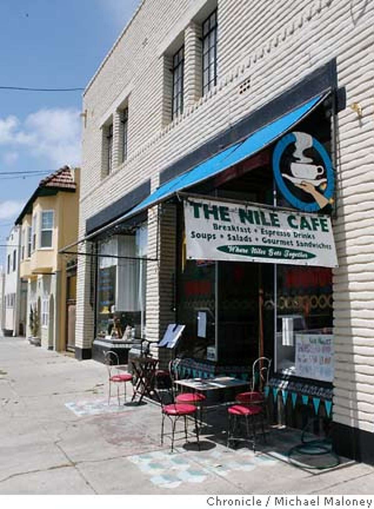 Street Date - Niles Blvd., Fremont. The Nile Cafe. 121 I Street is where the locals come to meet and eat. (510) 791-6049 Photo by Michael Maloney / San Francisco Chronicle on 5/25/06 in Fremont,CA Ran on: 06-01-2006 Left, a Charlie Chaplin wall hanging at Bite & Browse Antique Collective; below far left, Wayne Corrie of Corrie Glass heats up a nugget of italian soft glass to shape it into jewelry; below left, the Nile Cafe, where the locals come to meet and eat.
