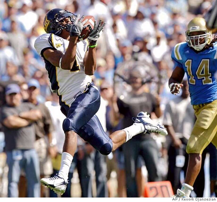 California wide receiver DeSean Jackson, left, catches a 39-yard touchdown pass from quarterback Nate Longshore as UCLA safety Chris Horton chases during the second quarter of a football game at the Rose Bowl in Pasadena, Calif., Saturday, Oct. 20, 2007. (AP Photo/Kevork Djansezian) Photo: Kevork Djansezian