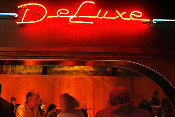 deluxe22_091_df.jpg  Poets, jazz musicians and fans of both came to Club Deluxe on Haight Street for the first anniversary of Poetry and Jazz Night. Photographed in San Francisco on 7/18/06.  (Deanne Fitzmaurice/ The Chronicle) Mandatory credit for photographer and San Francisco Chronicle. No Sales/Magazines out.