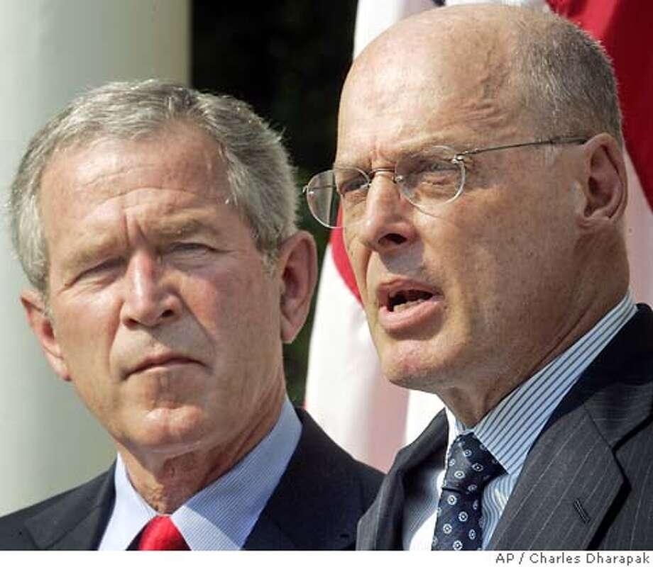 George Bush,  Henry M. Paulson Jr. Photo: CHARLES DHARAPAK