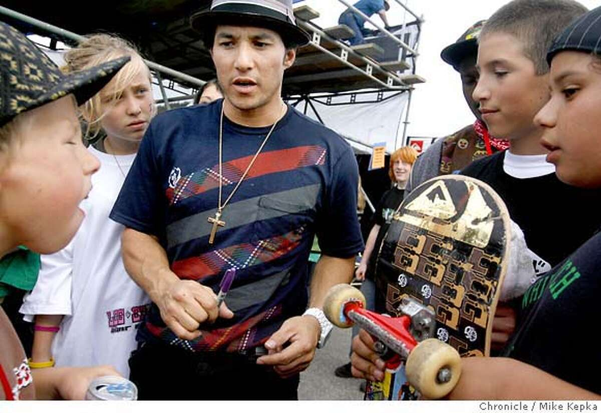Skateboarding legend Christian Hosoi is bombarded with autograph requests from the newest generation of skaters at a recent skateboarding demo in Pacifica, Calf.