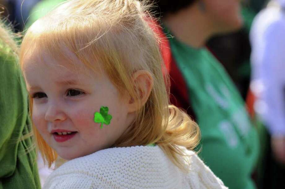 Two-year-old Adalyn McAuliffe of Albany watches the North Albany Limericks 62nd annual St. Patrick?s Parade in Albany, NY Saturday March 17, 2012.( Michael P. Farrell/Times Union ) Photo: Michael P. Farrell