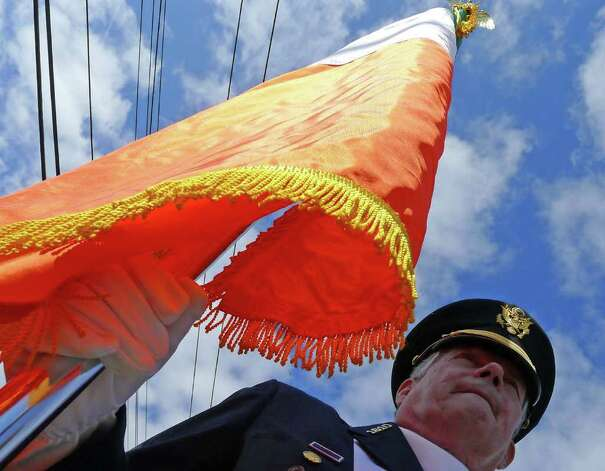 North Albany American Legion Post color guard member Ed Carroll carries the Irish flag during the North Albany Limericks 62nd annual St. Patrick?s Parade in Albany, NY Saturday March 17, 2012.( Michael P. Farrell/Times Union ) Photo: Michael P. Farrell / 00016862A