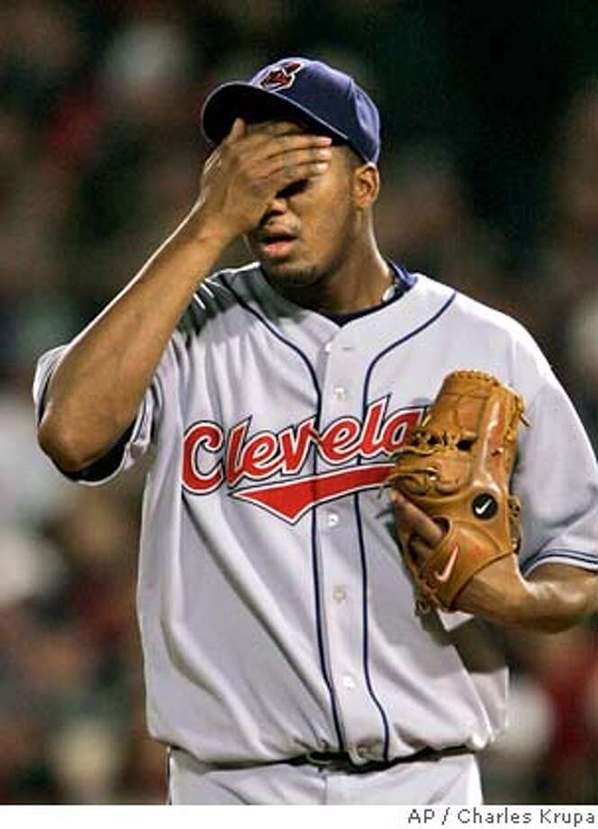 Cleveland Indians pitcher Fausto Carmona wipes his face during a rough third ining against the Boston Red Sox in Game 2 of the American League Championship baseball series Saturday, Oct. 13, 2007, at Fenway Park in Boston. (AP Photo/Charles Krupa) EFE OUT Photo: Charles Krupa