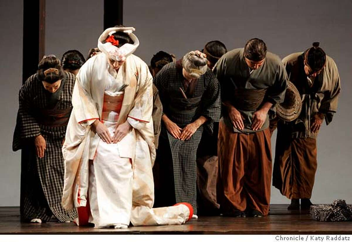 """BUTTERFLY_047_RAD.JPG SHOWN: Patricia Racette as Butterfly (wearing white)---she bows to Pinkerton (not shown), with family members behind her. The San Francisco Opera opens its summer season with """"Madama Butterfly."""" We shoot the final dress rehearsal in San Francisco, CA. on Wednesday, May24, 2006. (Katy Raddatz/The Chronicle) Photo taken on 5/24/06, in SAN FRANCISCO, CA. **Patricia Racette, Pinkerton"""