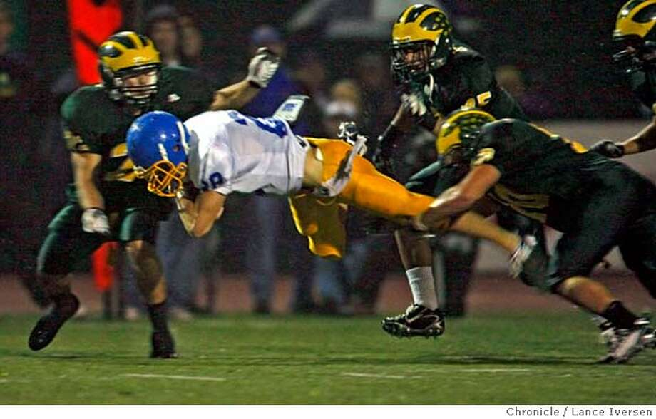 FOOTHILL2076678.JPG  Foothill's Austin Day stretches out for the first down in 2nd quarter action. San Ramon Valley Vs. Foothill.OCTOBER 19th, 2007. Lance Iversen/The Chronicle (cq) SUBJECT 10/19/07,in DANVILLE. CA. Photo: By Lance Iversen