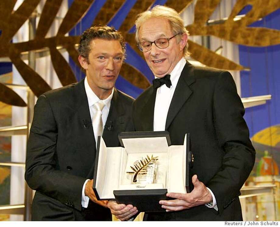 British director Loach displays the Palme d'Or award for his film 'The Wind That Shakes The Barley' at the 59th Cannes Film Festival Photo: JOHN SCHULTS