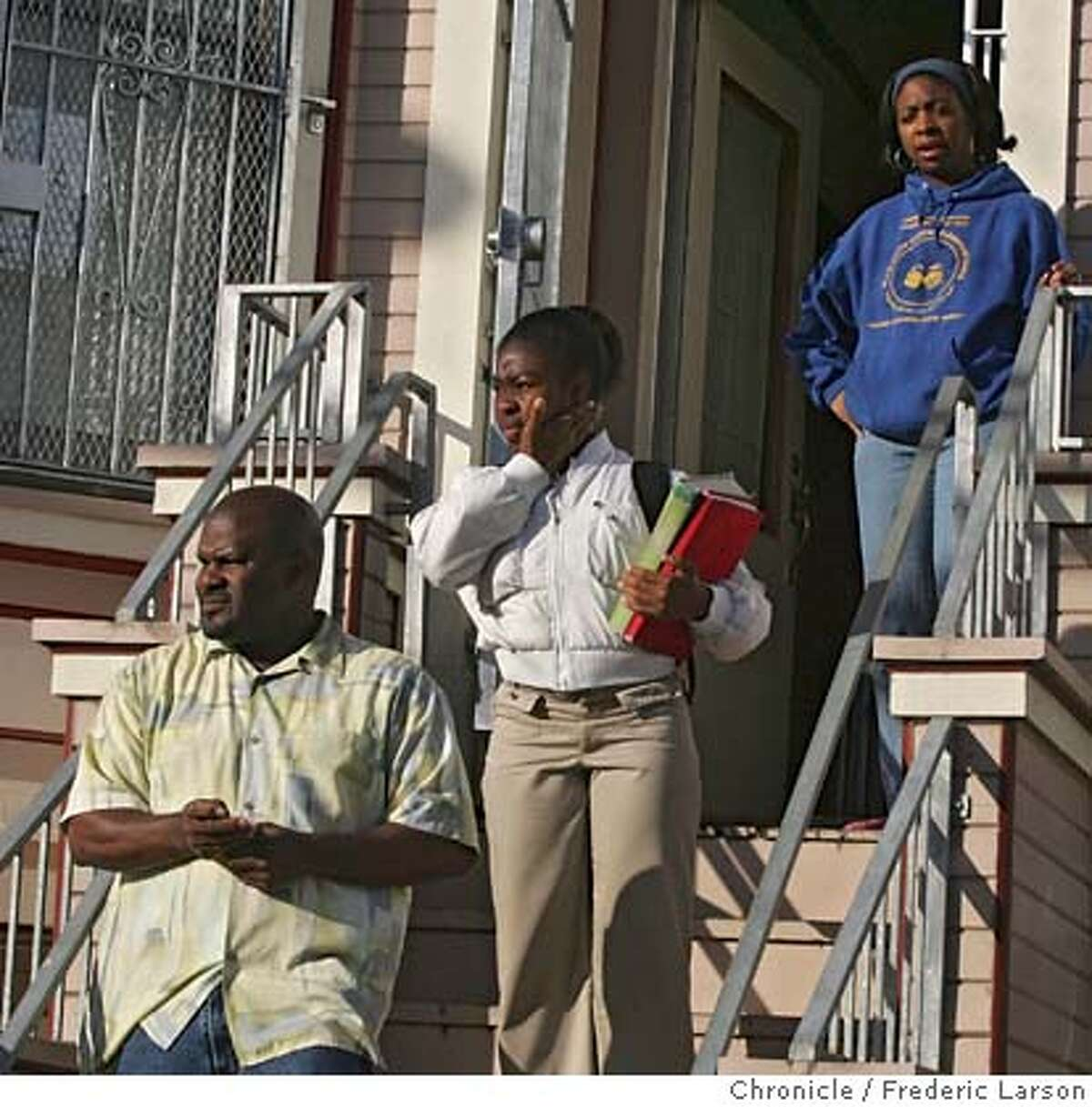 Omar Khallf takes his 12-year-old daughter Lailah Duke to Kipp Academy in the Bayview district, SF as Lailah mother (top) Carla Duke sees her off. Omar Khallf, a candidate for the school board who believes in neighborhood schools. 5/24/06 {Frederic Larson/The Chronicle} ** Omar Khallf, Lailah Duke,Carla Duke MANDATORY CREDIT FOR PHOTOGRAPHER AND SAN FRANCISCO CHRONICLE/ -MAGS OUT