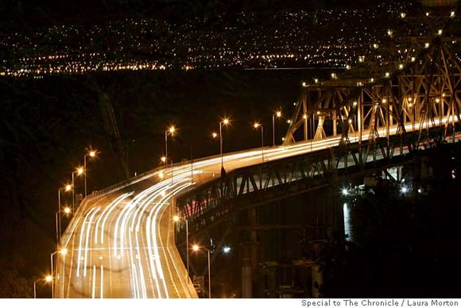 BAYBRIDGE04_0238_LKM.jpg Cars cross the Bay Bridge Monday night, a few hours after it re-opened with a new viaduct. (Laura Morton/Special to the Chronicle) Photo: Laura Morton