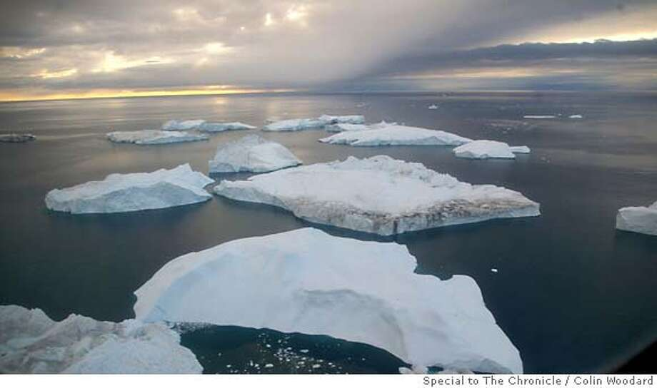 .jpg Icebergs released by a glacier near Ilulissat, Greenland. Colin Woodard / Courtesy to The Chronicle Photo: Colin Woodard