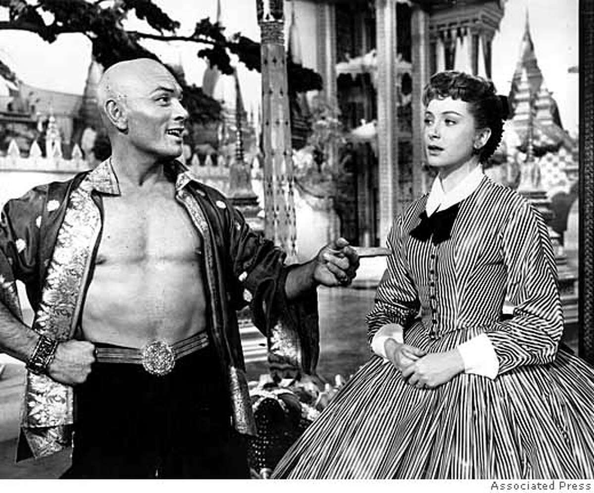 """**FILE**Yul Brynner and Deborah Kerr share a scene in """"The King and I"""" in March 1957. Kerr, who shared one of cinema's most famous kisses with Burt Lancaster in """"From Here to Eternity,"""" has died in Suffolk, eastern England, her agent said Thursday, Oct. 18, 2007. She was 86.(AP Photo)"""