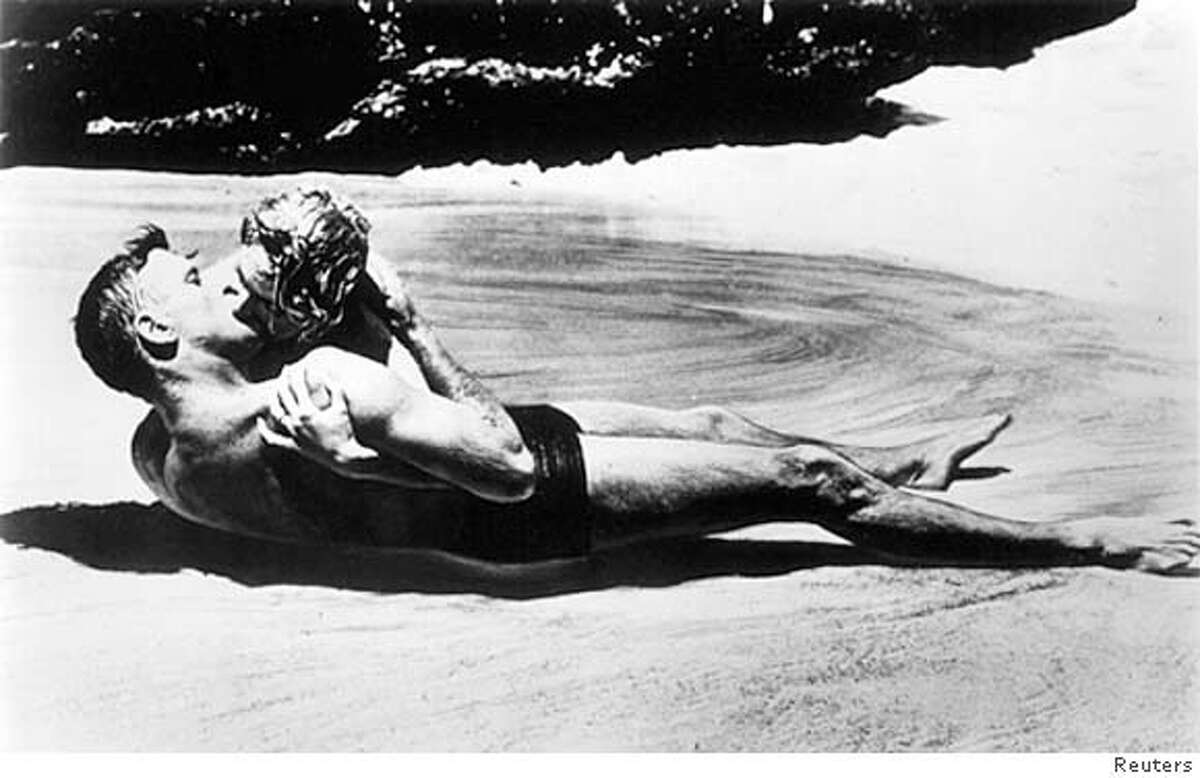 """Actors Deborah Kerr and Burt Lancaster kiss on the beach in a scene from the movie """"From Here to Eternity"""" in this undated file photograph. Kerr died on October 16, 2007 in England at age 86. REUTERS/Handout (UNITED STATES). EDITORIAL USE ONLY. NOT FOR SALE FOR MARKETING OR ADVERTISING CAMPAIGNS. NO ARCHIVES. NO SALES. Ran on: 10-19-2007 The King and I -- Deborah Kerr starred as Anna, the teacher of the children of the king, who was played by Yul Brynner."""