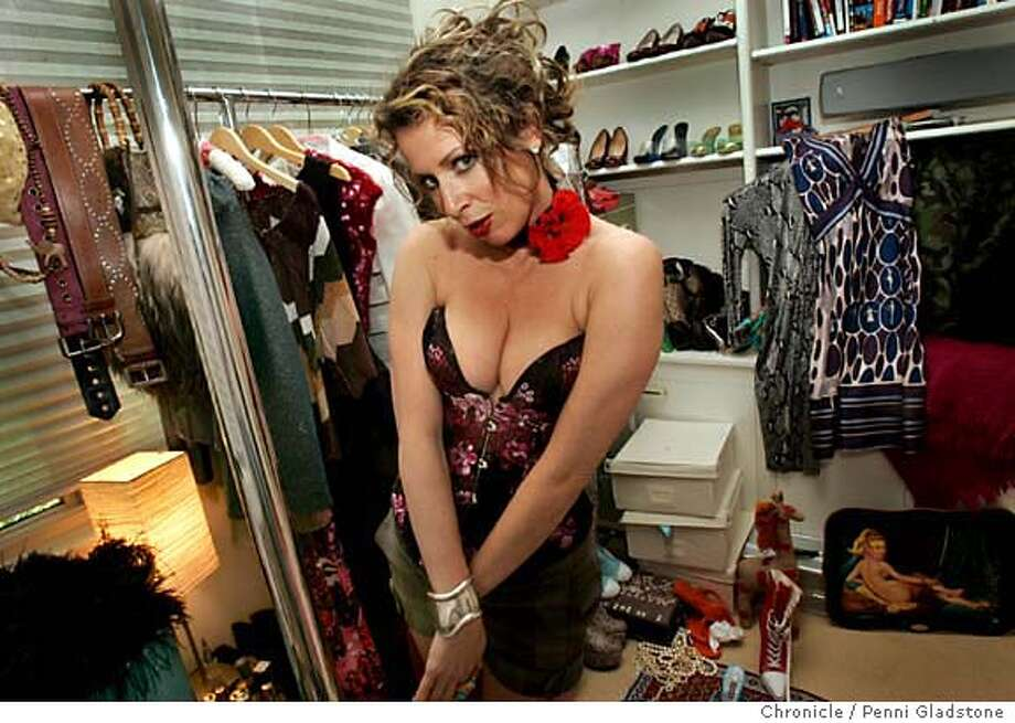 "BOOSTER14  Wearing a corsete, in a room with lots of her stuff, Author jennifer solow, author of the recently published novel ""the booster"" Not your average soccer mom in general."" because the book has lots to do with clothes and her passion for fashion, photo by penni gladstone, sf chronicle Photo taken on 5/4/06, in Mill Valley, CA. Photo: Penni Gladstone"
