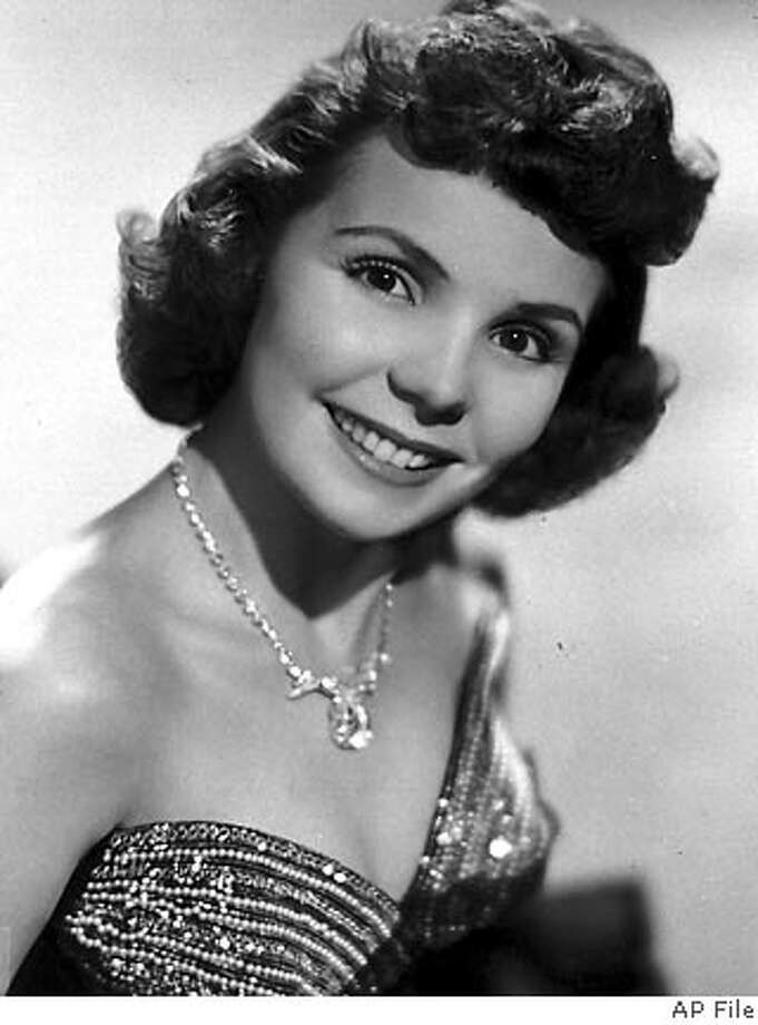 "**FILE** This file photo from 1956 shows singer Teresa Brewer.Brewer, who topped the charts in the 1950s with hits like ""'Till I Waltz Again with You,"" died Wednesday Oct. 17, 2007. She was 76. (AP Photo/File) Photo: AP"
