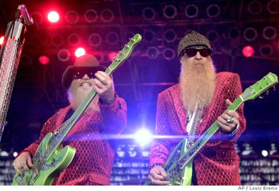 ZZ Top performs onstage at the Mississippi Valley Fair Friday, Aug. 5, 2005, in Davenport, Iowa. (AP Photo/Quad City Times, Louis Brems) Ran on: 08-19-2005  ZZ Top's Dusty Hill plays the bass while guitarist Billy Gibbons (right) handles one of his Gretsch guitars. Photo: LOUIS BREMS