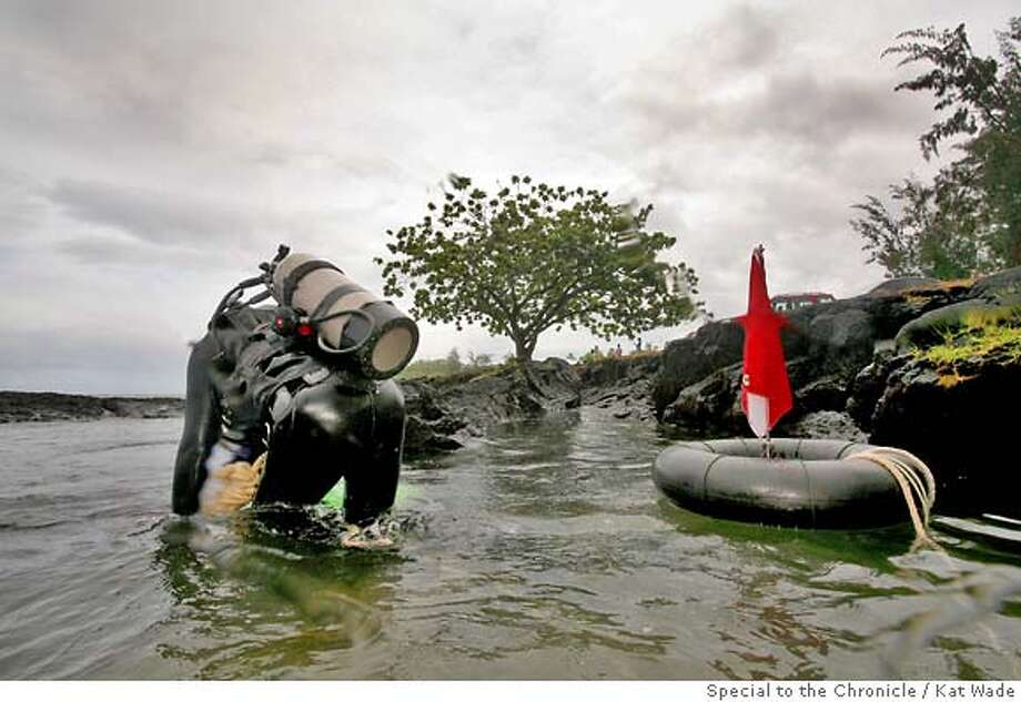 PROJECTAWARE_Hilo_0093_KW.jpg  Bill DeRooy owner of the Nautilus Dive Center crawls across a lava reef to pick up garbage in the ocean at 4-mile beach in Hilo, Hawaii as part of the largest ever International underwater cleanup effort organized by Project Aware, volunteer divers breath air donated by Nautilus Dive Center in Hilo, Hawaii, as they pick up hundreds of pounds of plastics, bottles, cans, fishing line and lead, spark plugs and other miscellaneous garbage from beneath the ocean on Saturday September 15, 2007. Kat Wade/ Bill DeRooy (CQ, subject) Photo: Kat Wade